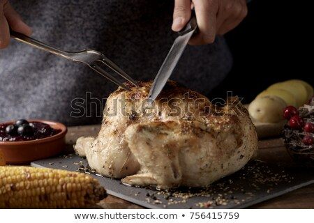 young man carving a roast turkey stock photo © nito