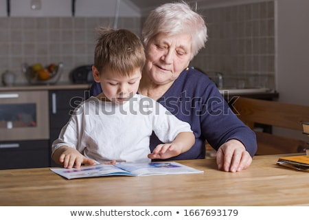 A grandmother reading to her grandson Stock photo © IS2