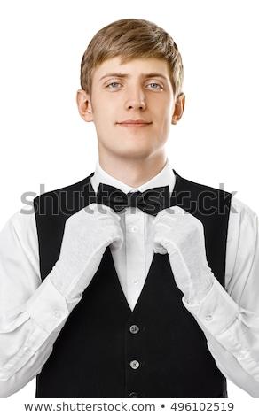 relaxed elegant man in tuxedo fixing his bowtie  Stock photo © feedough