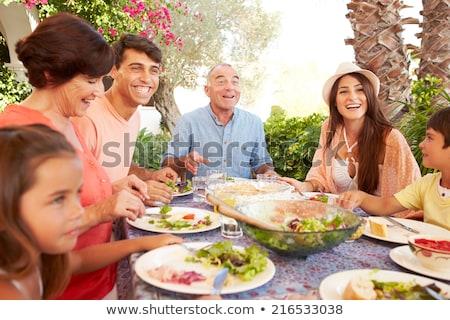 família · camping · tenda · cozinhar · comida · feliz - foto stock © is2