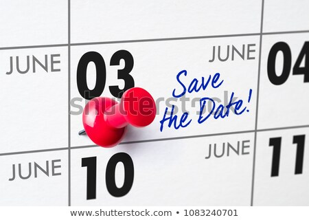 wall calendar with a red pin   june 03 stock photo © zerbor