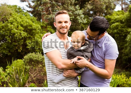Souriant gay couple enfant maison maison Photo stock © wavebreak_media