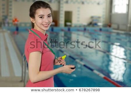 плавать тренер глядя секундомер женщину фитнес Сток-фото © wavebreak_media