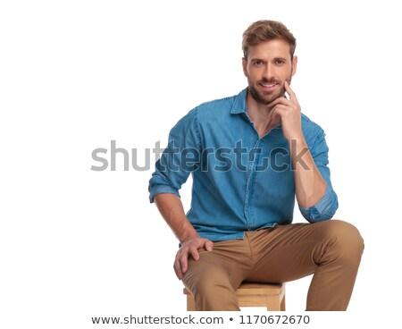 Homem empurrando dedo bochecha pensativo pose Foto stock © feedough