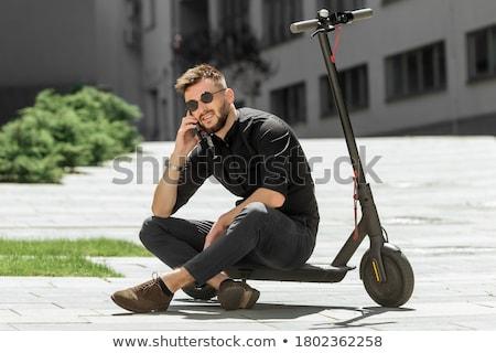 若い男 ライディング 電気 スクーター 現代 景観 ストックフォト © jossdiim