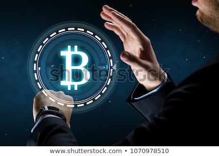 Imprenditore Smart guardare bitcoin ologramma business Foto d'archivio © dolgachov