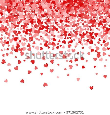 Red pattern of random falling hearts confetti. Border design element for festive banner, greeting ca stock photo © olehsvetiukha