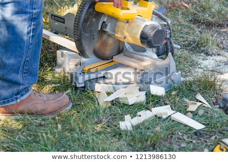 Stock photo: Worker Using Electric Miter Saw At Constrcution Site