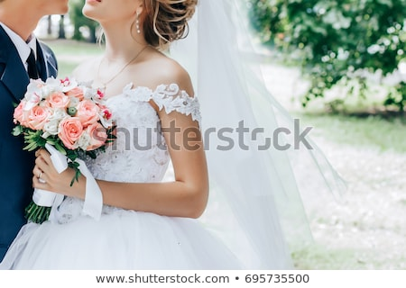Gyönyörű virágcsokor kezek menyasszony elegáns fény Stock fotó © ruslanshramko