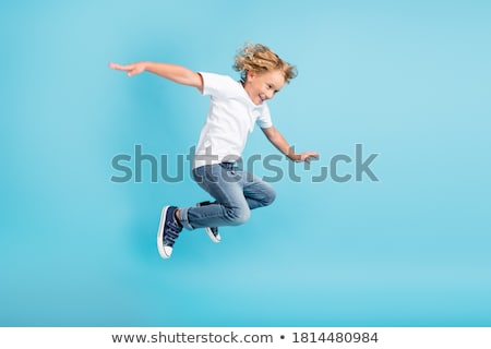 Happy boy jumping on trampoline stock photo © colematt