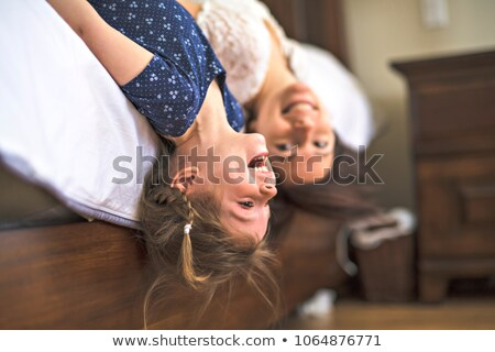 mother playing with her baby in the bedroom upside down Stock photo © Lopolo