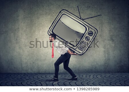 buisness man carrying a big tv set on his back stock photo © ichiosea