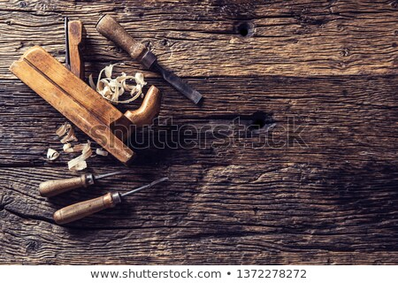 Top view of carpenter hand working with wood planer Stock photo © Kzenon
