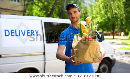 Delivery Service, Worker with Bag and Parcels Stock photo © robuart