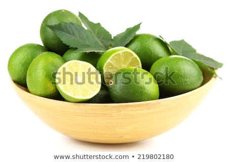 close up of whole limes in bowl Stock photo © dolgachov