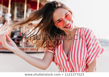 Happy attractive young woman with an amused smile Stock photo © Giulio_Fornasar