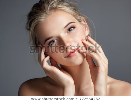 Beautiful face of young woman with cosmetic foundation on a skin Stock photo © serdechny