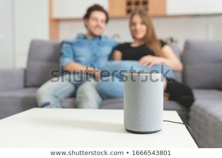 Casal ouvir música inteligente alto-falante sorridente Foto stock © AndreyPopov