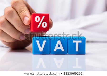 Person Placing Red Percentage Block Over Vat Stock photo © AndreyPopov