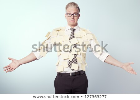 Miserable businessman covered by blank yellow stickers.  Stock photo © lichtmeister