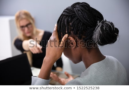 African Woman Sitting In Front Of Female Boss Blaming Her Stock photo © AndreyPopov