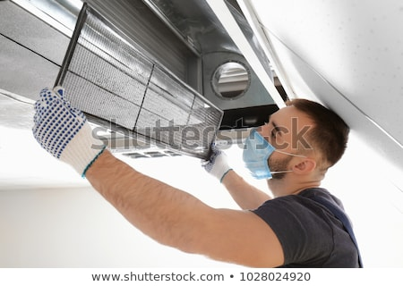 Stock fotó: Worker Cleaning Air Condition Equipment