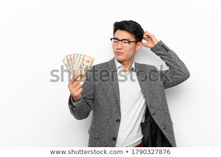 confused young man with euro and dollar money Stock photo © dolgachov
