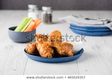 Blue cheese garlic chicken wings Stock photo © Peteer
