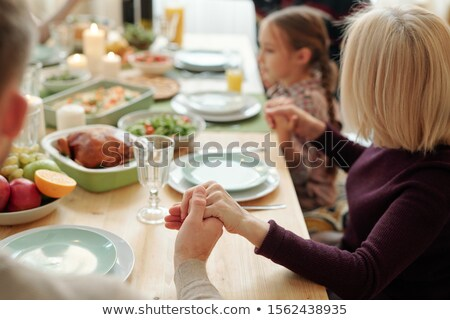 Hands of young man, mature blonde woman and little girl held by each other Stock photo © pressmaster