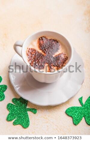 Craft paper composition of green shamrock's leaf. Stock photo © artjazz