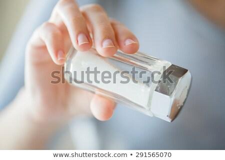 Közelkép kéz tart só pince öntet Stock fotó © dolgachov