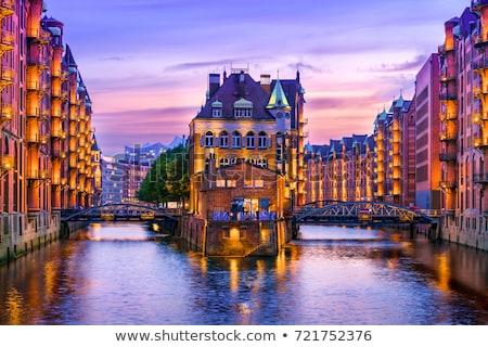 öreg Hamburg Németország naplemente víz város Stock fotó © elxeneize