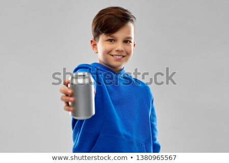 smiling boy in blue hoodie holding can drink Stock photo © dolgachov