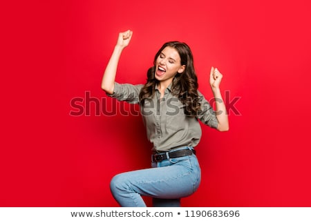 smiling red haired girl celebrating success Stock photo © dolgachov