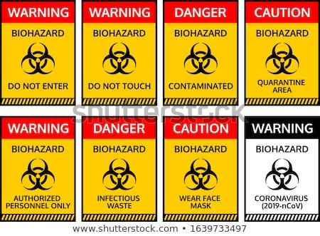 Warning sign with crossed out Coronavirus bacteria. Stock photo © artjazz