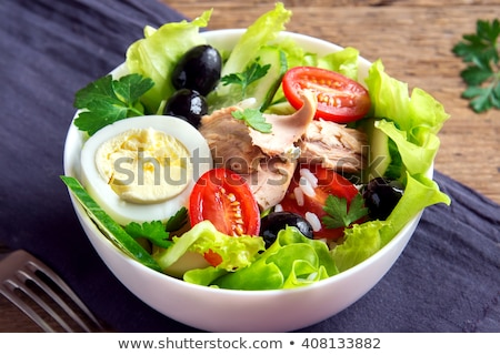Homemade tuna salad with fresh organic vegetables and egg. Stock photo © artjazz