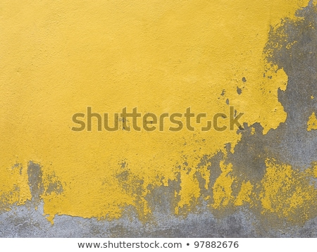 Old grunge decayed yellow textured wall Stock photo © boggy