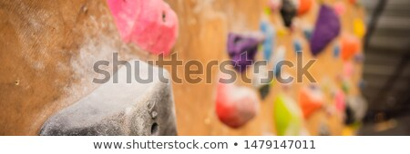 Wooden wall with climbing holds in gym BANNER, LONG FORMAT Stock photo © galitskaya