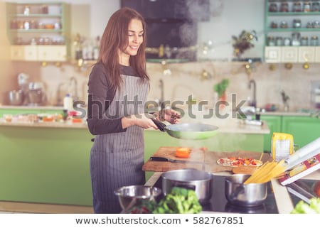 Woman Cooking in Kitchen at Home, Cozy Interior Stock photo © robuart