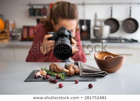 close up of woman photographing mushrooms Stock photo © dolgachov