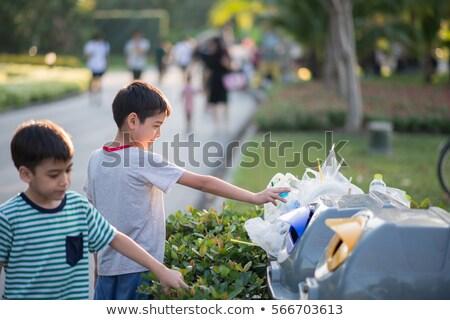 Kicsi aranyos fiú dob papír újrahasznosít Stock fotó © galitskaya