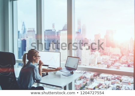 Woman Works in Brokers Exchange Company, Analyzing Stock photo © robuart