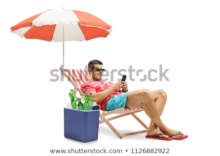 smartphone in a deck chair on the beach Stock photo © nito