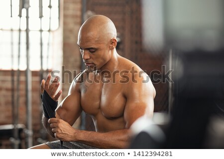 Weightlifting wrist straps fitness man Stock photo © Maridav