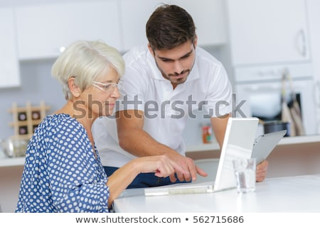 man helping an elderly lady with her laptop stock photo © photography33