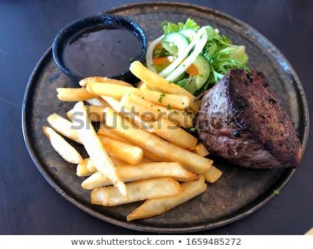 biefstuk · salade · vork · eten · tomaat - stockfoto © M-studio