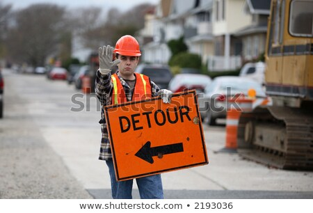 a road worker holding an arrow sign stock photo © photography33
