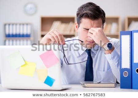 Túlhajszolt üzletember iroda telefon fiatal stressz Stock fotó © photography33