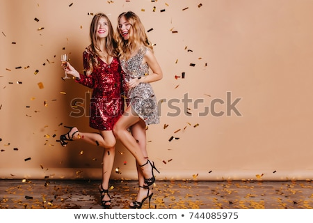 beautiful young model wearing party dress stock photo © stockyimages