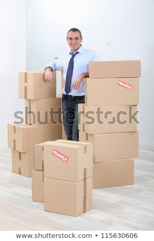 Man with piles of cardboard boxes marked fragile Stock photo © photography33